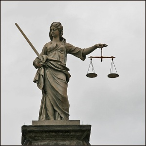 the pros and cons of outsourcing - the scale of justice